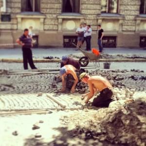 Lviv Ukraine, cobble stone road repair